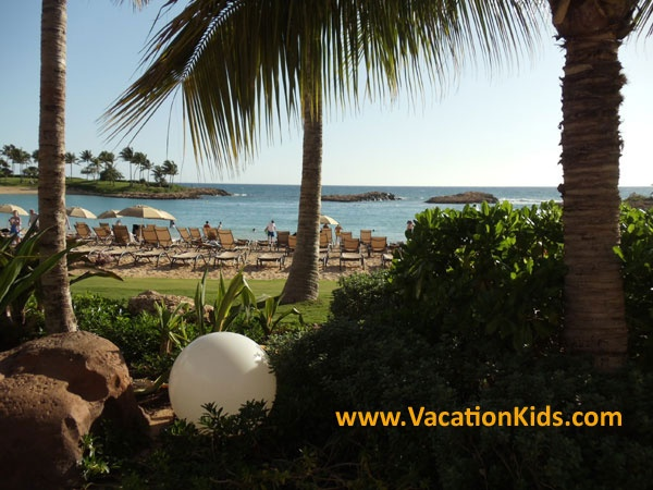At Disney Aulani Resort the beach is lined with shady palms by day and by night it glows