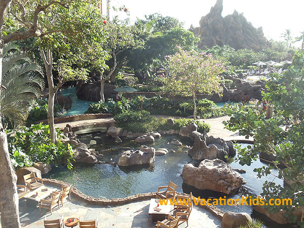 Enchanting koi fish ponds intertwine with the pool play areas in the Waikolohe valley at Disney Aulani