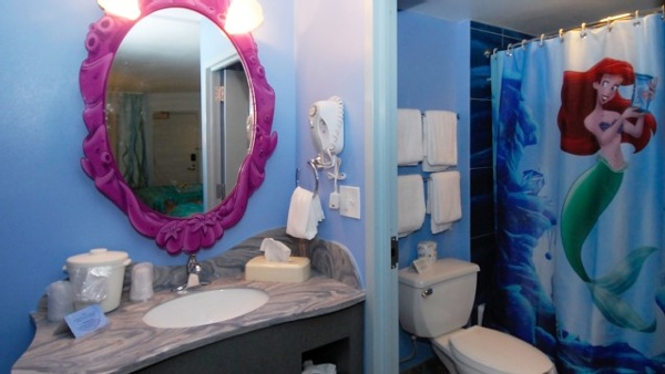 Art of Animation bathrooms offer a sink dressing area that is separated by a door to the bathroom that has the toilet and shower. All the decor will make you feel like you are deep in the ocean with Arial