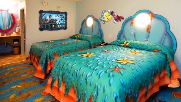 Art of Animation Little Mermaid standard rooms offer 277 square feet of living space with a dressing area near the sink that separates with a privacy curtain