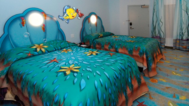 Disney Art of Animation Little Mermaid rooms offer two DOUBLE beds with clam headboards that will sleep a family of 4 plus one infant under the age of 3