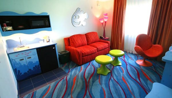 The Living Room area in Art Of Animation Finding Nemo Suites offers families a double sleeper sofa and mini kitchenette with small fridge, microwave and sink