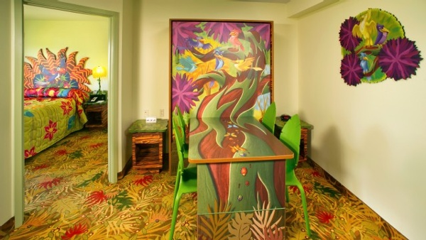 Art Of Animation Lion King family suite offers a dining room table that will seat 6 by day and sleep two by night