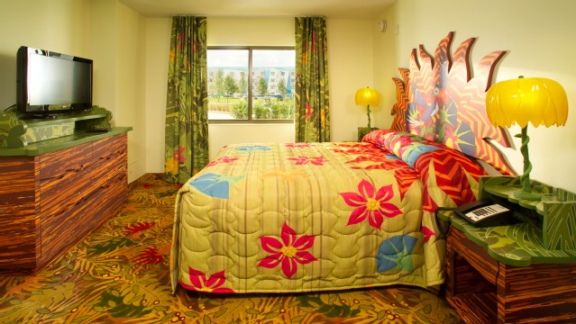 Art Of Animation Lion King family suites offers parents a master bedroom and bathroom separated by a door for extra privacy