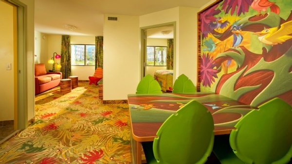 Art Of Animation Lion King family suites comfortably sleep 6 with a living room, separate master bedroom, Two full bathrooms and a dining room with a table that converts to a double bed.