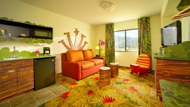 Art of Animation Lion King family suite offers families a double sleeper sofa, separate TV and mini kitchenette