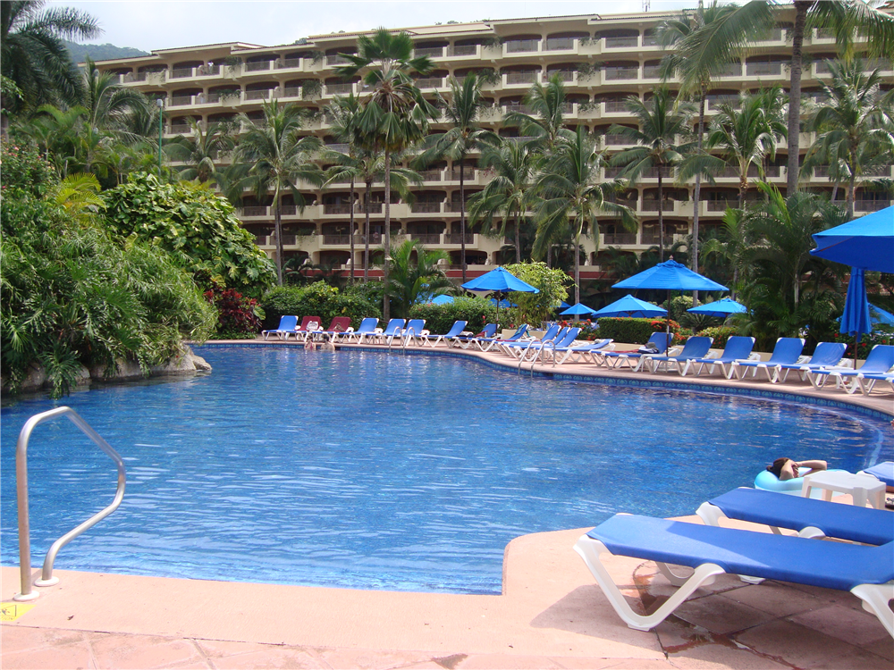 Relax by the pool with a refreshing drink at Barcelo Puerto Vallarta