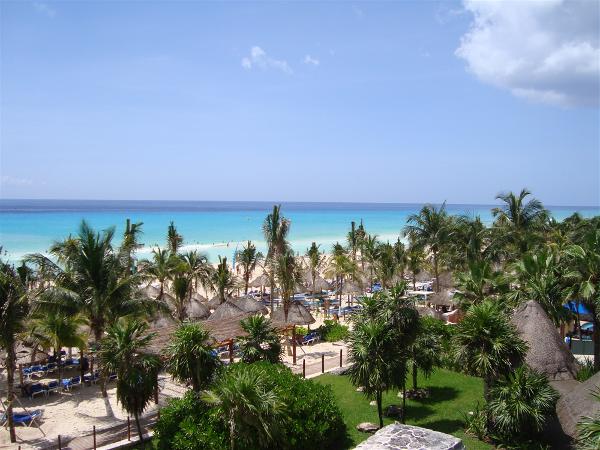 Enjoy the beach and bright blue waters of the Sandos Playacar Beach Resort & Spa