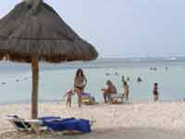 Family on the beach of the Oasis Palm Cancun Resort