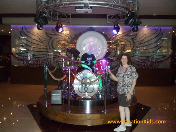 Vacationkids Sally Black with Led Zepplin's drum set in the lobby of the Hard Rock Cancun Hotel