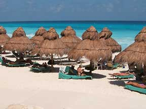 Omni Cancun Hotel and Villas beach view of shady palapas