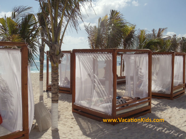 Beach beds at the Krystal Hotel Cancun are waiting for you and your family