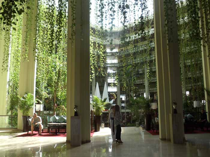 The 9 story hanging gardens in the atrium of the Paradisus Cancun is a beautiful spot for a family destination wedding.