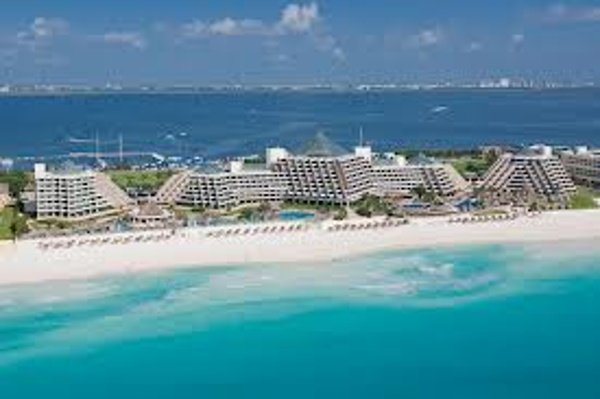 Ocean view of the 5 pyramid buildings of the Paradisus Cancun all inclusive resort.
