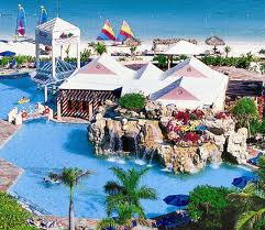 View of the main pool and waterfalls at the Caribbean village of Beaches Turks & Caicos