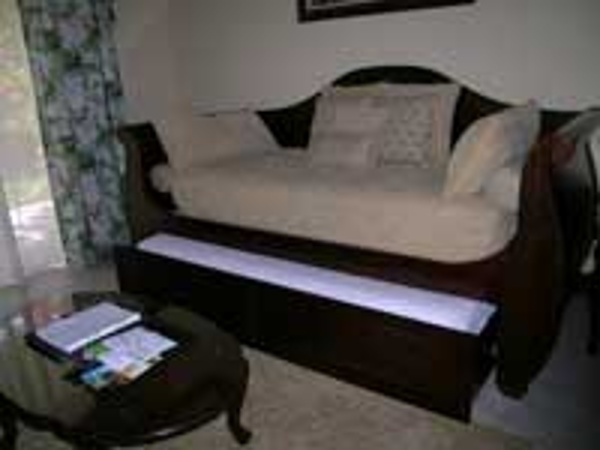 Mahogany trundle daybed sleeps two kids at Beaches Turks & Caicos