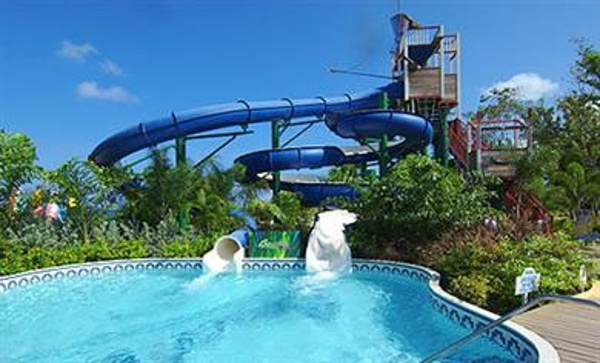 Pirates Island Water Park, an 18,000 square foot area with 200' long waterslides, a plunge pool and whirlpool, in addition to a lazy river, misting pool and swim-up bar for adults