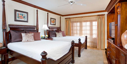 Rooms at Beaches Negril are elegantly appointed with mahogany furnishings