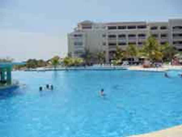 Huge Infinity pool with swim up bar at Iberostar Rose Hall beach Resort in Jamaica