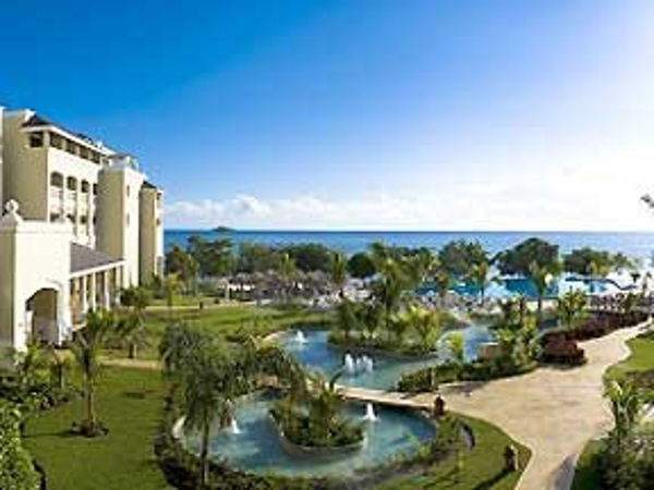 Iberostar Rose Hall Beach Resort in Jamaica offers a huge infinity pool that stretches right to the Caribbean Sea