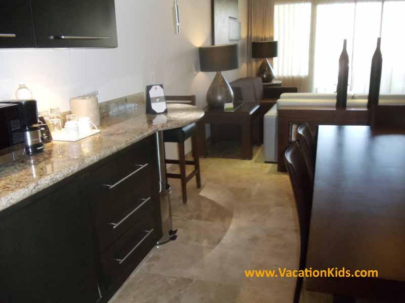 Living room of the 1 bedroom family concierge suite at the Paradisus La Esmeralda Resort