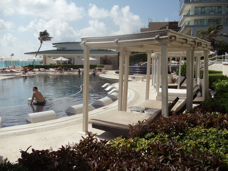 Sandos Cancun pool side beach beds
