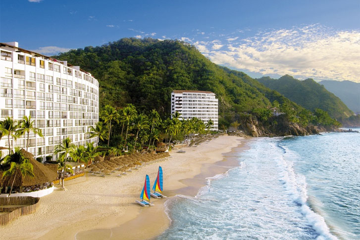 View of the beach and 2 tower buildings at Dreams Puerto Vallarta