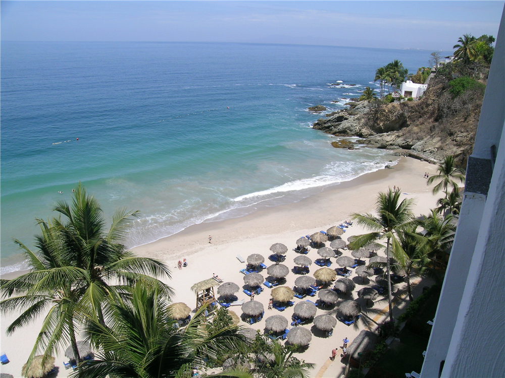 view of the right side of the beach from our room at Dreams Puerto Vallarta overlooking the bay of Banderas