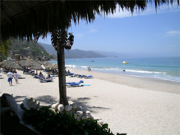 Kick back in shady spot or enjoy the sunshine on the beach of Dreams Puerto Vallarta with your family