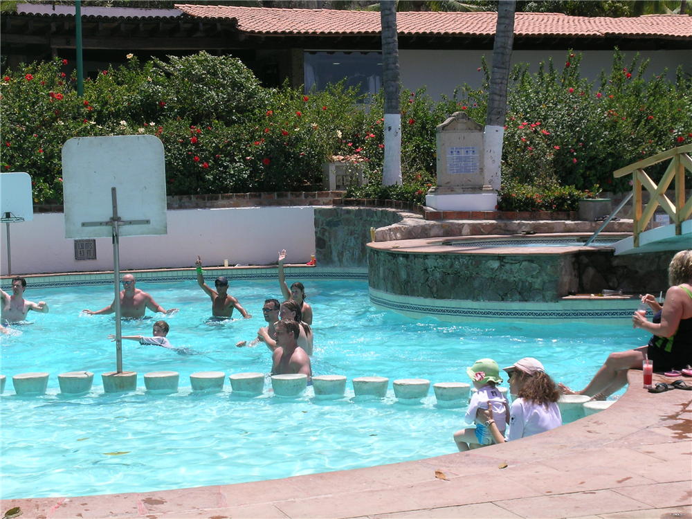 Main pool with swim up bar and kids swim area at Dreams Puerto Vallarta