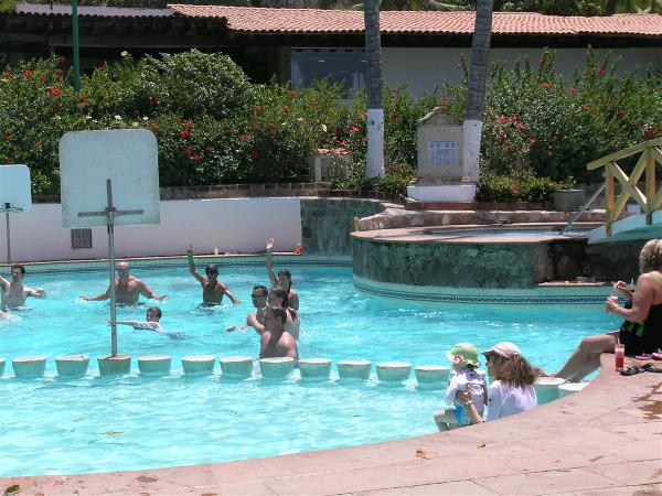 Main pool with swim up bar and kids swim area at Dreams Puerto Vallarta