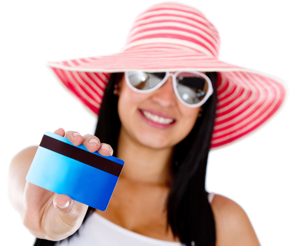 Woman paying her holidays by credit or debit card - isolated over white
